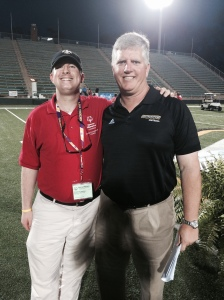 Athlete Leadership Council member Channing Ewing takes a photo with SLU Head Football coach Ron Roberts at the 2014 State Summer Games Opening Ceremonies