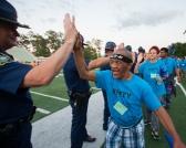 Athlete high fiving officer 2