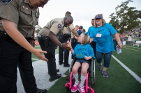Athlete high fiving officer 3 (in chair)