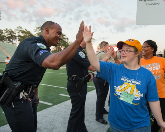 Athlete high fiving officer