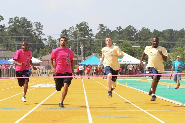 athletics athletes crossing the finish line