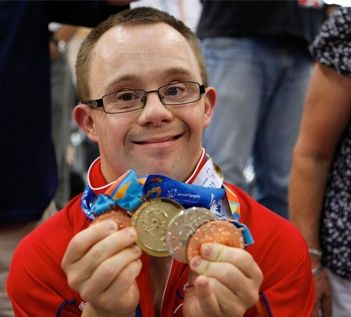 Athlete showing medals off